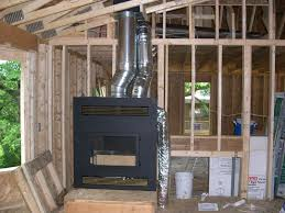 the z max fireplace photo above shows the remote ducting the 8 duct on the right of the fireplace flue transferring the heat from the fireplace to the