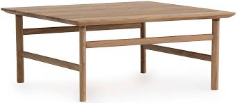 made in solid oak the grow coffee table take its its aesthetic from the danish shaker style her name grow refers to the light curve connecting her