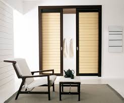 innovative detail on modern sliding door design beside comfortable chair and simple side table