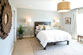 rug on carpet bedroom. Rug On Carpet Bedroom Rugs Contemporary With Beige Curtains Dark Wood Bed Drum . P