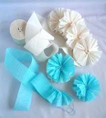 crepe paper rosettes are a great way of saving those pieces of paper and ribbon you might have around your craft room or studio