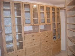 master with raised fronts and glass doors this closet features many drawers