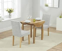 mark harris promo oak round extending dining table with 2 maiya grey chairs