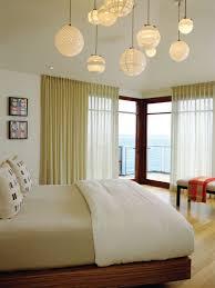 lighting for bedrooms ideas. minimalist light wood floor bedroom photo in orange county with beige walls lighting for bedrooms ideas m