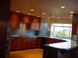 spectacular recessed lights fixtures kitchen ceiling ideas over u shape brown wooden kitchen cabinetry in open views kitchen designs