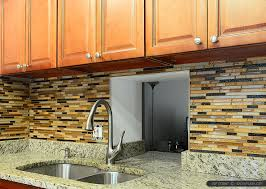 image of venetian gold granite countertops and tile backsplash