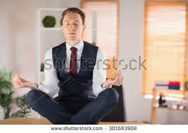 meditation businessman office. calm businessman meditating in lotus pose his office meditation i
