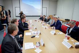 and state department senior adviser thorne sit with a group of clean energy industry executives at the outset of a roundtable discussion in
