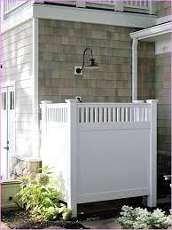 showers outdoor shower enclosure ideas with white colors wall and nice flowers simple style e