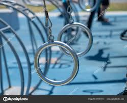 low hanging gymnastic rings hanging in an outdoor workout space stock photo