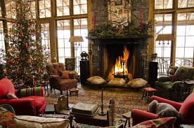living room ideas classic mantel decoration idea with tall red candle lights along with greens along with tree and red sofas