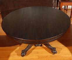 claw foot coffee table zoom pictures image this cool round pedestal coffee table has the original cast iron casters below the hand