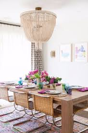 this dining room decor features an overscale natural fiber chandelier is an elegant addition that nicely echoes the boho dining table
