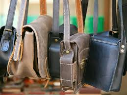 a leather purse with outside pockets is one of the most functional accessories any woman can have in her closet after all it can easily hold her