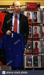 Avram Glazer looks around Manchester United's Mega Store at Old Trafford in  Manchester, northern England, June 30, 2005. Peace returned to Old Trafford  on Thursday when Manchester United's new bosses Joel, Bryan