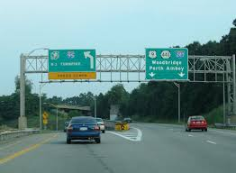 the new jersey turnpike on ramp departs exit 129 for interstate 95 a massive toll plaza lies ahead before respective directional ramps onto either the cars
