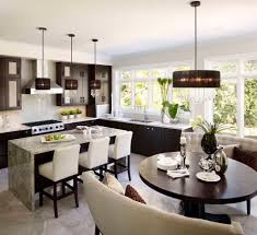 natural modern design interior dining and kitchen room kitchen fashion chandeliers with round dining table and cream sofas on the cream floor tile