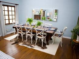 simple dining table decor. dining roomdecorated with rectangular frameless mirror in the blue walls and simple room table centerpieces decor e