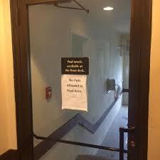 Dont prop door open sign on door with a broken lock so anyone can