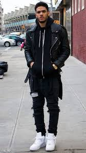 a black leather jacket and black distressed skinny jeans are a perfect combination to be utilised