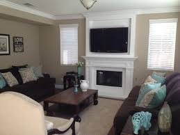 fireplace mantel with crown molding and flat screen tv