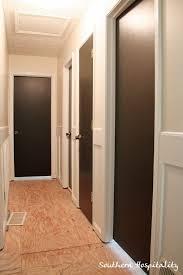 painting interior doors dark chocolate brown great way to update plain hollow core doors