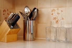 create room for a ceramic backsplash by removing the preformed backsplash on your countertop