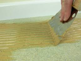 trowel glue adhesive applying flexible flooring