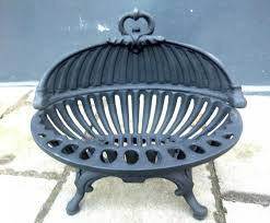 image of oval cast iron fireplace grate