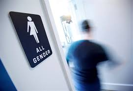 school bathroom sign. Interesting Bathroom Image FILE PHOTO  A Bathroom Sign Welcomes Both Genders At The Cacao  Cinnamon Coffee In School Bathroom Sign R
