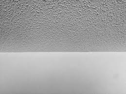 photo of popcorn drywall texture on the ceiling and smooth walls