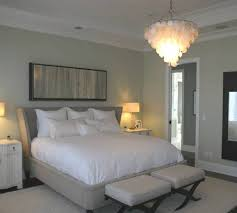 pretty capiz shell chandelier hanged on white wall plus bed under it for bedroom design ideas