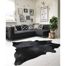 solid black cowhide rug