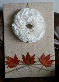 an easy and inexpensive way to cover an electric fuse box queen of where is the fuse box in house then i shopped my house to decorate the boards my coffee filter wreath seemed to be just right for the top so i attached it with a string of twine and