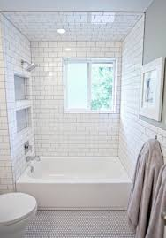 an all white bathroom with 3x6 subway tile on the walls and white penny rounds