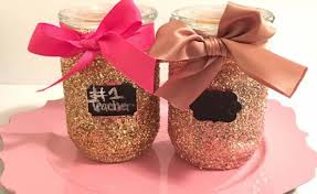 give those simple glass containers a sparkling look using glitters tie ribbons on the rim