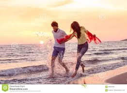 Happy Young Romantic Couple In Love Have Fun On Beautiful Beach At
