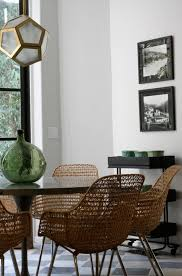 honeyb pendant wicker mid century chairs and a tulip table image via garrison hullinger