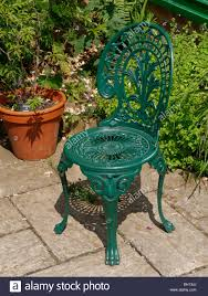 painted metal patio furniture green ornate cast garden chair on slabbed with furniture l26 furniture