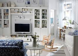 white wooden rocking chair. Living Room. Blue White Sofa Beside Round Wooden Table Plus Small Brown Rocking Chair