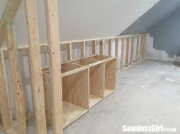 building a wall behind cabinets to position them correctly in the room