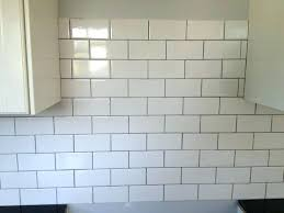 white glass subway tile with black grout tiles