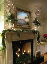 lights in the gold and silver hurricane globes are topped with red dogwood branches greens and candles in the fireplace architectural landscape