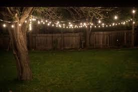 backyard string lights and flowers home plan design