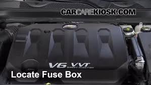 replace a fuse 2014 2016 chevrolet impala 2014 chevrolet impala locate engine fuse box and remove cover