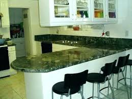 white kitchen cabinets with dark green granite countertops backsplash home impro