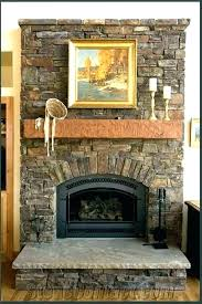 remodeled fireplace faux rock stone mantels rock fireplace fire place outdoor designs pictures faux painting before