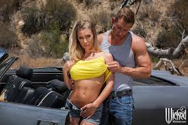 Blonde Nicole Aniston Wearing Jeans Shorts in Car Image Gallery.