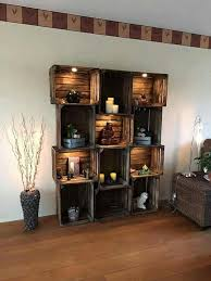 wooden crate wall shelves over baseboard heater and around front window a bookcase and dvd of