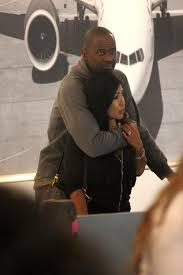 Brian McKnight and wife seen at LAX. 11 3 Page 2